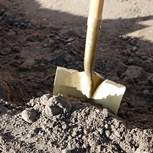 gold shovel dirt groundbreaking