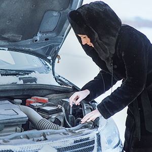 girl repairing car winter road, Is it necessary to warm up your car, Is it bad to warm up your car, How long does it take for a vehicle to warm up